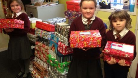 These R3 pupils spent the morning helping Road of Hope pack all 70 shoe boxes from our school :-)